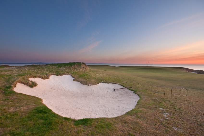 Bunker on a golf course at sunrise